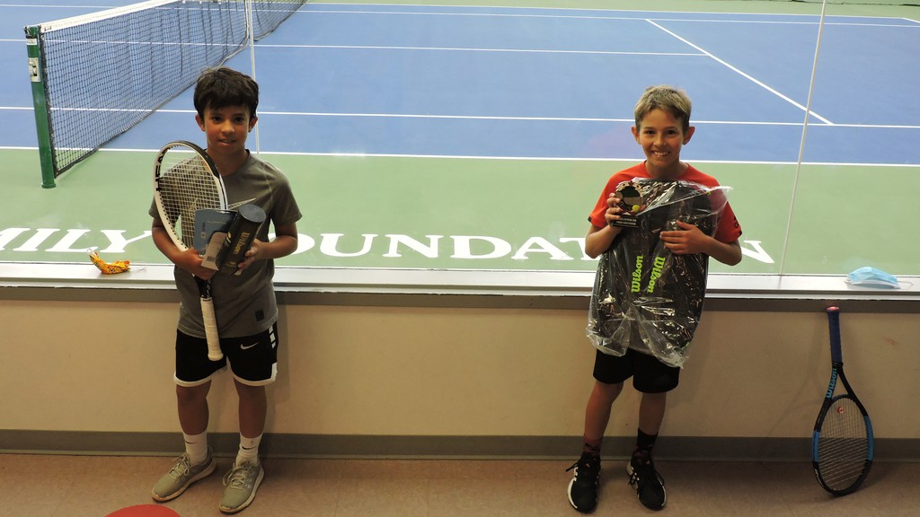 Fredericton's Callum McMorran, right, defeated Simon Mujoomdar of Halifax, left, in the U12 boys final of the the Sussex Junior provincial tennis tournament, which started in Sussex and concluded in Fredericton due to rain.