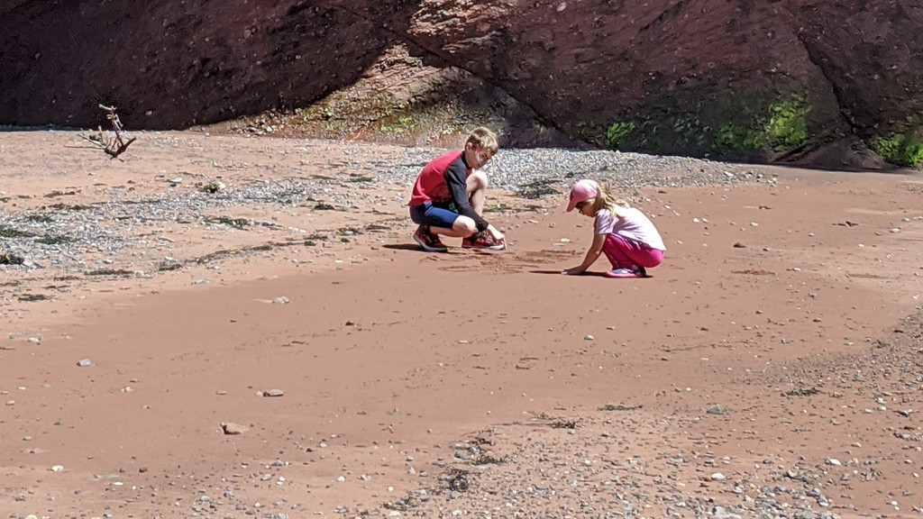 Thomas and Ashley explore the shore in St. Martins