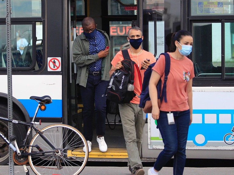 People get off the bus at the Vendôme Metro station on the first day that wearing masks on public transit is mandated in Montreal.