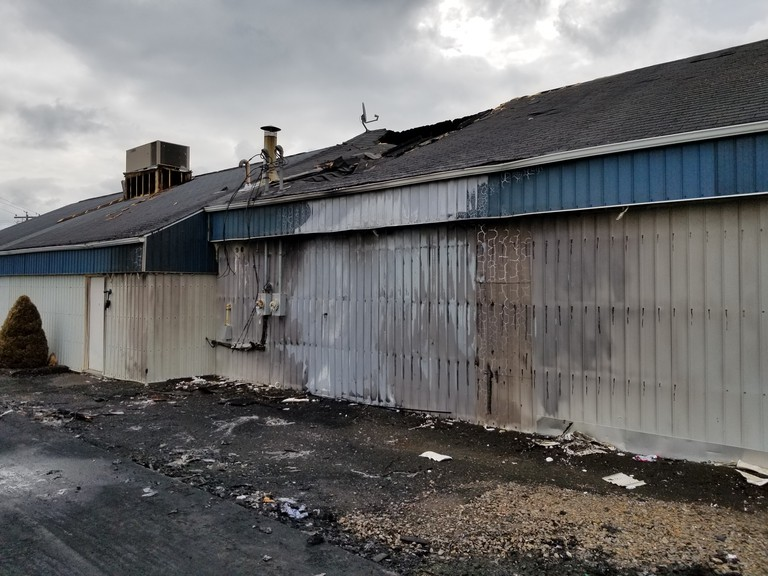 Squeaky's Car Wash, a Perth-Andover business, was damaged after a vehicle fire spread to the building on Sunday afternoon.
