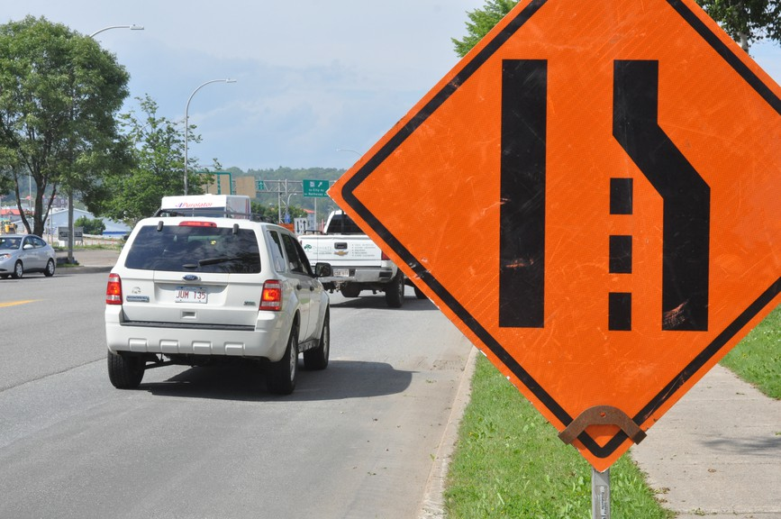 Construction workers on Route 1 experienced a close call while working. A video posted shows a white car speeding through the construction zone past several vehicles and nearly striking several workers.