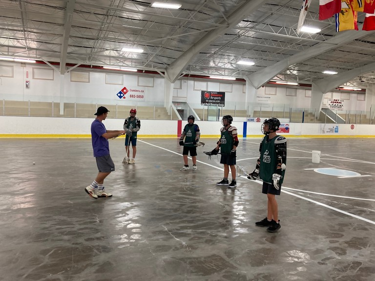 Head coach Chet Koneczny talks lacrosse with prospective players during a series of Team NB tryouts in preparation for the 2021 Jeux du Canada Games.