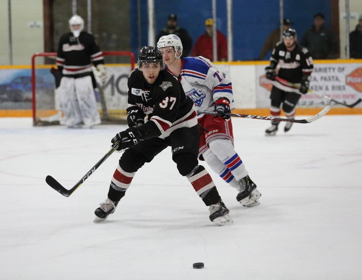Miramichi Timberwolves defender Antoine Leblanc, 37, attempts to clear the puck from Summerside Western Capitals winger Nick Reeves during a 2019-20 Maritime Junior Hockey League game at Miramichi Civic Centre. The Wolves and MHL hope to open the 2020-21 season Oct. 2, but the league's return-to-play plan remains a work in progress.