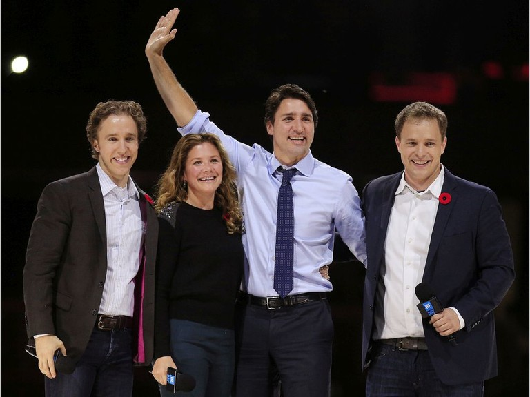 Prime Minister Justin Trudeau and his wife, Sophie, are flanked by We Day co-founders, Craig Kielburger, left, and his brother Marc, right, who testified last week about cabinet's decision to award them a major government contract.
