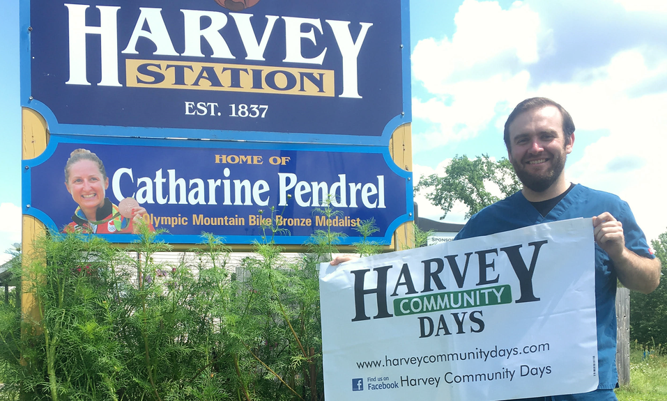 Harvey Community Days chairperson Dr. Dan Fletcher, pictured by the welcome sign leading into the community, says the 75th annual version of the event will go on next month despite the pandemic. He said the celebration will incorporate virtual events with drive-thru food services, all of which are designed to protect people from COVID-19.