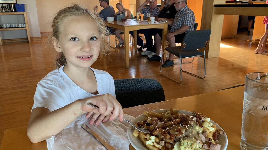 Lily Oudot shows off her first prize winning plate of poutine during a poutine bar contest at the Covered Bridge Golf and Country Club on Wednesday night.
