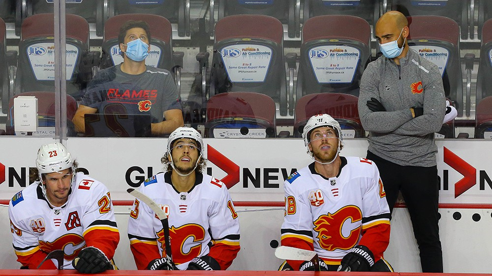Calgary Flames Sean Monahan, Johnny Gaudreau and Elias Lindholm are shown on the bench during a intra-squad game at the Saddledome in Calgary on July 19. Monahan had six points in four games as the Flames beat the Winnipeg Jets 3-1 in the NHL play-in series in Edmonton.