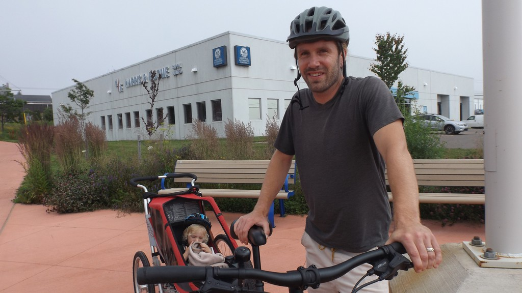 Harry Daley bikes his son, Jasper Daley, 2, to daycare. He said he has to take a longer route through the city to avoid busy roads in order to keep his son safe.