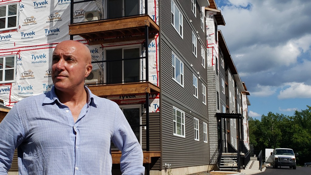 Fredericton real estate developer Gabriel Elzayat in front of his almost-finished apartment building on Clark Street.