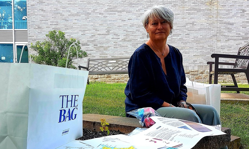 Adda Mihailescu, manager of the organization's public programs at the Beaverbrook Art Gallery, displays the contents of the Art Camp BAG for children ages 6 to 12.