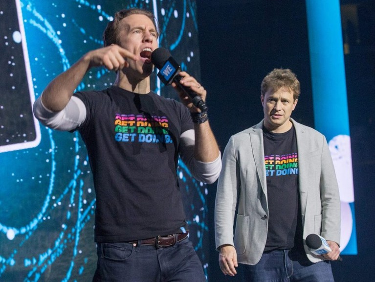 Craig Kielburger and his brother Marc Kielburger (right) take to the stage as WE Day takes place at Canadian Tire Centre in Ottawa.