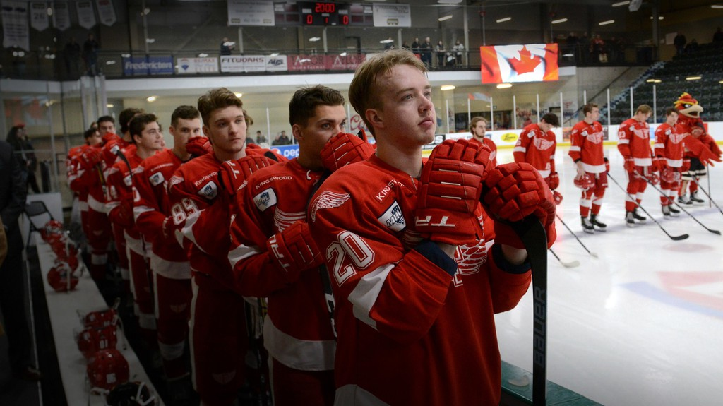Aaron Brown (20) and his Fredericton Red Wings teammates stand for the national anthem before a Maritime Hockey League game in January at the Grant-Harvey Centre. The junior A league is hoping to run a full 52-game schedule, starting Oct. 2.
