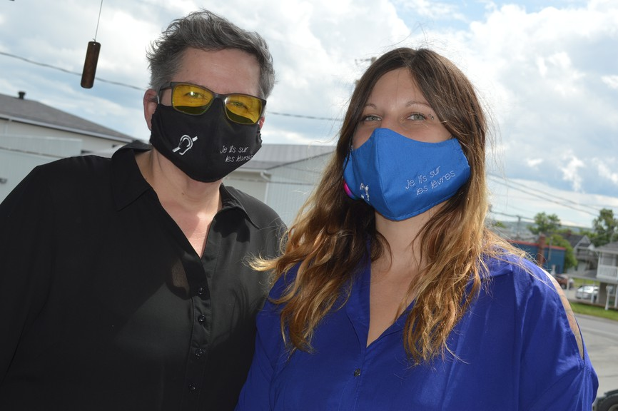 Wilma C. Morin, left, wears a mask that shows she is deaf and reads lips. She is shown here with her daughter, Élaine Carbonneau