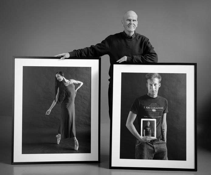 James Wilson standing beside his figure portraits of Stéphanie Audet (ballet dancer, 2019) and James Divine (student, 2012).