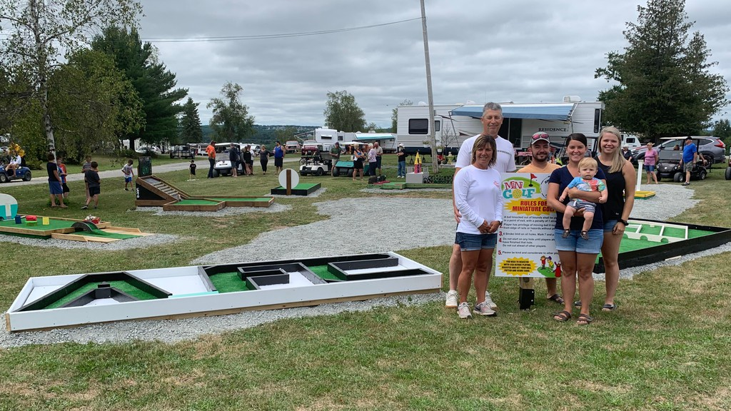 Lisa and Brent Antworth, far left, stand with their children and grandson next to the new mini golf course at Antworth's Family Campground. They unveiled the latest addition to the campground on Aug. 1.