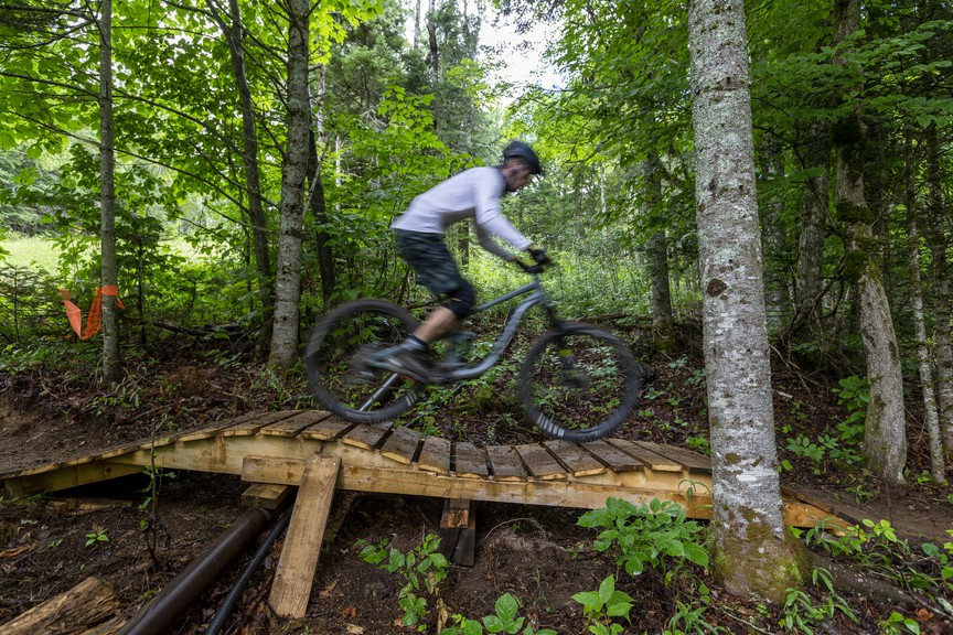 Strewn throughout Poley Mountain's mountain bike trials are wood features, including this rolling bridge. Snow school director Jamie Touchie said the inaugural year for mountain biking at Poley was a success.