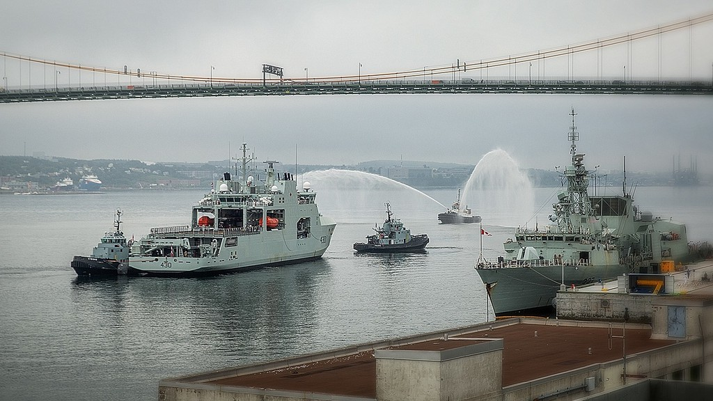 HMCS Harry DeWolf – the first Arctic Offshore Patrol Ship – is escorted by Atlantic Towing tugs as part of the delivery ceremony on Friday with Canada's Navy.