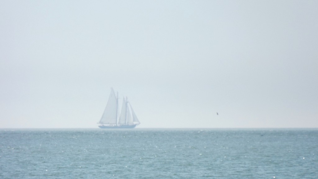 The Bluenose II could barely be seen through the fog off the shore of Saints Rest Beach shortly after noon on Sunday.