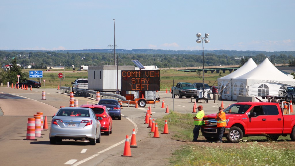 Cars line up to enter Nova Scotia from New Brunswick on Sunday afternoon.