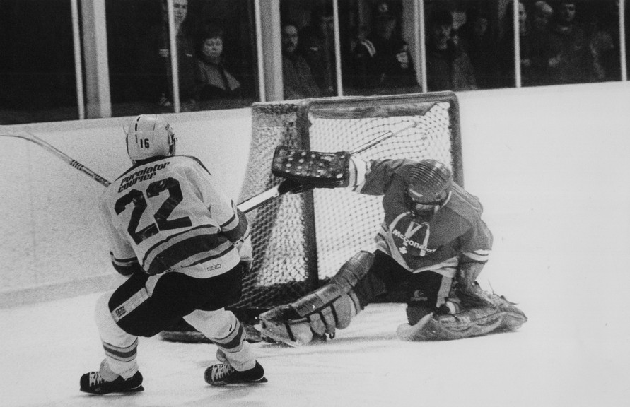 This Jan. 30, 1989, photo shows South all-star Doug Way of Oromocto putting the puck past North all-star goaltender Eric Tremblay in hockey action.