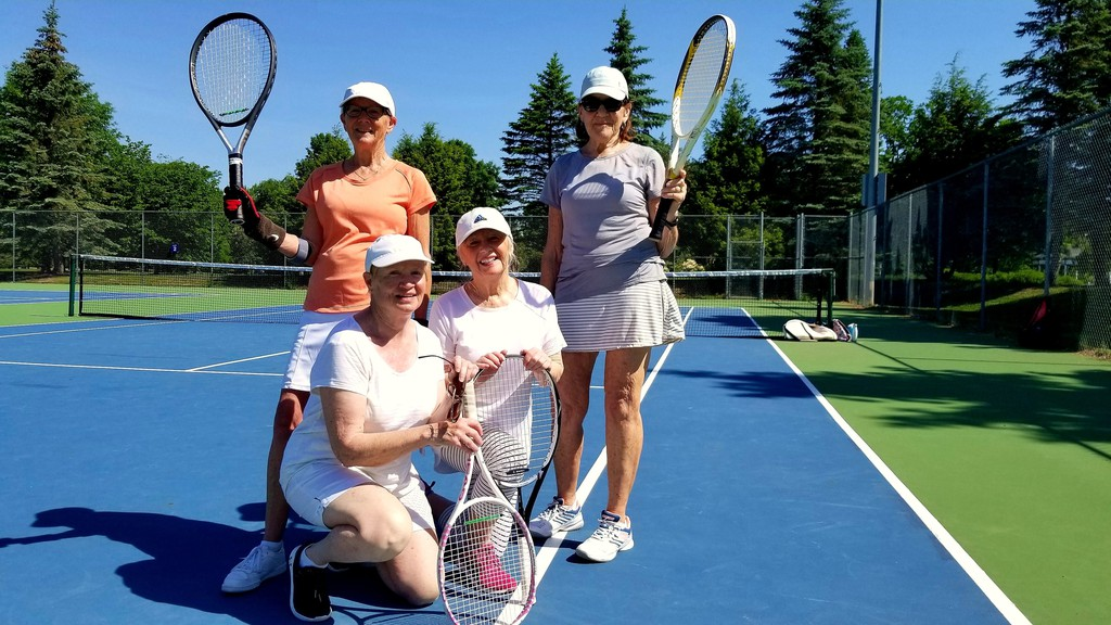From left, Sandra Grant and Heather Akin, and standing, Nancy Williston and Denise Dorcas have been enjoying playing doubles matches at Fredericton's Wilmot Park tennis courts in this file photo.