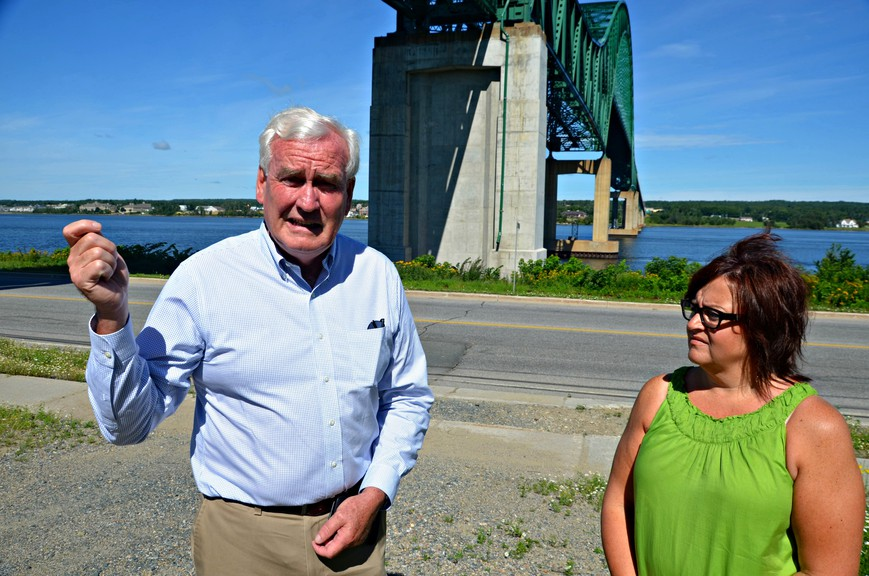 Provincial Liberal leader Kevin Vickers, left, and Miramichi Bay-Neguac MLA Lisa Harris speak at a press conference Tuesday under the Centennial Bridge in Chatham. Vickers and Harris say the larger overhaul planned for the bridge this year still needs to go ahead, and the resurfacing work currently being tendered doesn't go far enough.