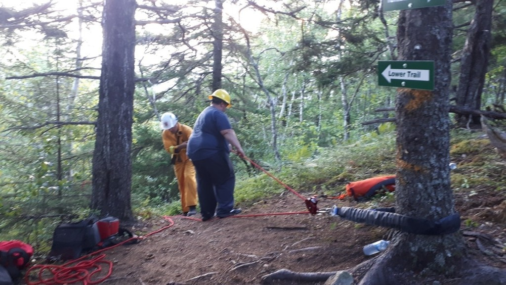 Emergency personnel respond to a call to rescue an injured hiker from a Bald Mountain trail on Sunday.
