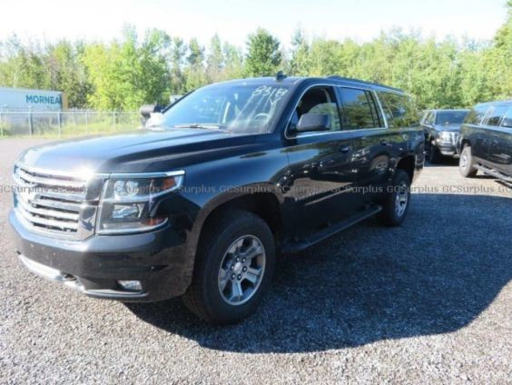 A 2018 Chevy Suburban is listed for sale on the GC Surplus website.