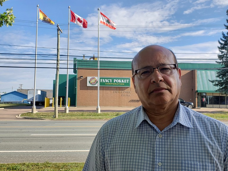 Mike Timani stands in front of Fancy Pokket in Moncton on Tuesday. Timani said he will be spending time messaging friends, family and members of the Lebanese-Canadian community as news continues to come in of those affected by an explosion in Beirut.