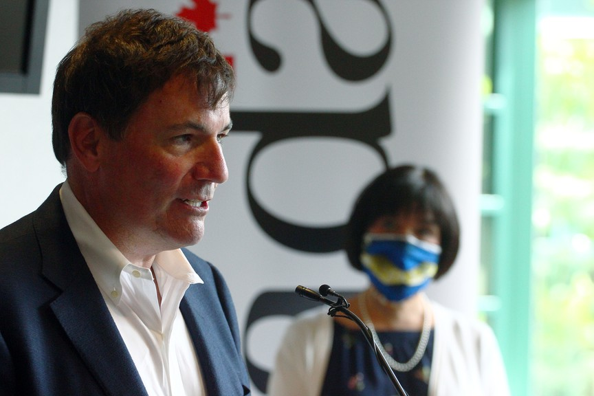 Beausejour MP and cabinet minister Dominic LeBlanc speaks at a press conference at Moncton city hall Wednesday. Moncton-Riverview-Dieppe MP Ginette Petitpas-Taylor is seen in the background. The feds say they will now pay a significantly higher portion of the price tag to get infrastructure projects built quickly in New Brunswick and across the country.