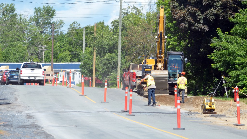 A construction crew works on new curbing and sidewalk on Houlton Street in Woodstock in 2020 in a file photo. The town will likely use a funding boost from federal COVID relief fund for additional capital projects.