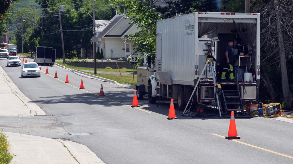 Eastern Trenchless Ltd. works on a new sewer lining project on Connell Street in Woodstock on Wednesday.