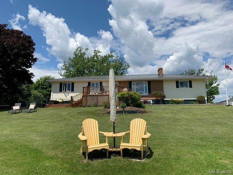 Enjoy calming views of the Miramichi River and the quaint city it runs through it from your back deck with this recently-renovated bungalow located at 10 Beverly Ct. in Miramichi.