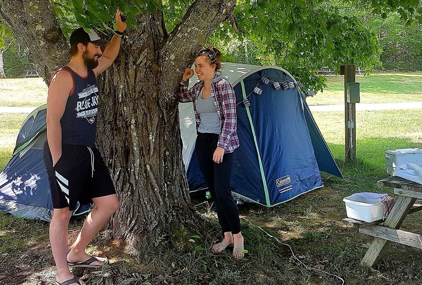 Clifton Royal resident Gary Pevlin chats with Molly Jenkins at their Mactaquac Park campsite Monday. Pevlin said Mactaquac was packed with campers over the weekend.
