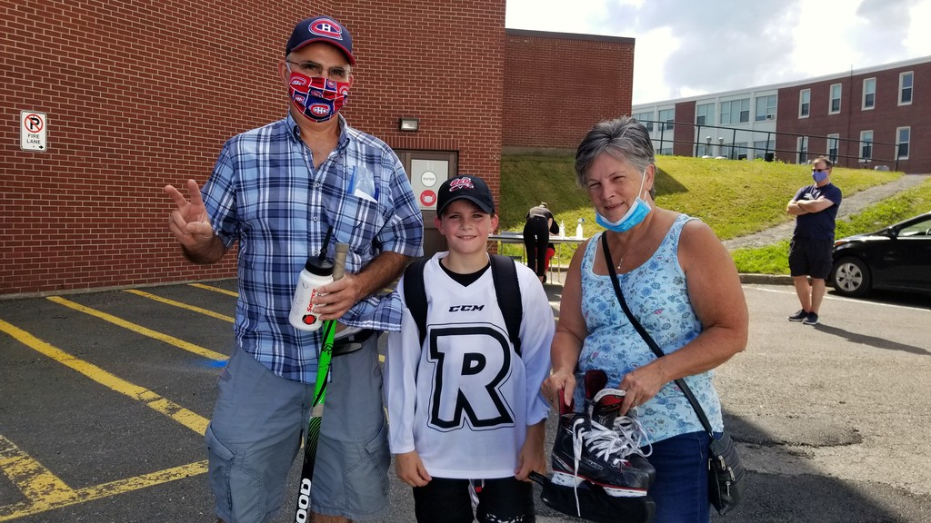 Cole Gilmore, 10, had grandparents Drew and Wendy Robertson get him to and from the first UNB Reds power skating and skills ice session at the Aitken Centre on Monday. The summer camps are back despite the COVID-19 pandemic.
