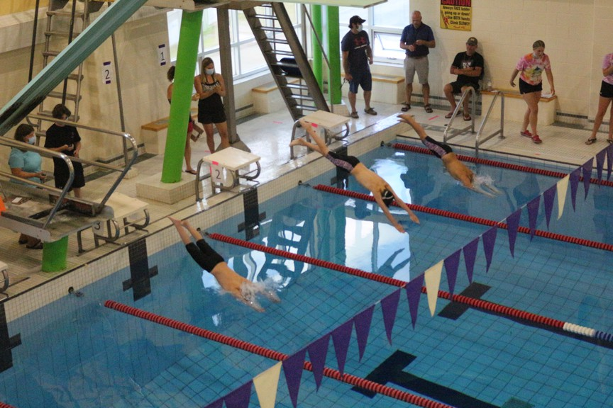Swimmers jump into the pool to start a race during a recreational swim meet at the Ayr Motor Centre in Woodstock in a file photo. Woodstock will borrow an additional $650,000 to pay for additional energy retrofit project costs.