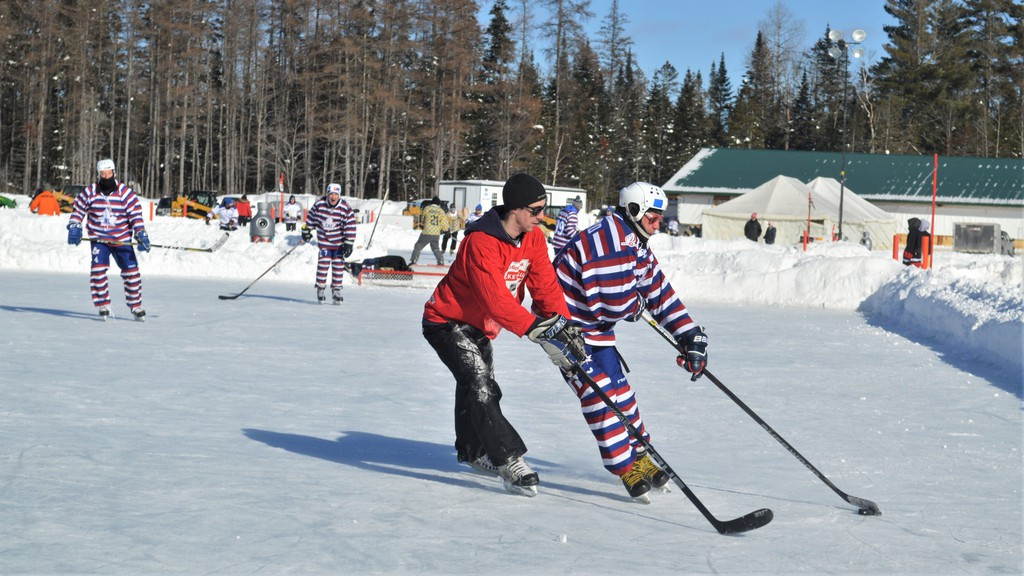 Brad Kennedy of local team the Raggedy Ass River Boys makes a play against one of the Montreal Lagers squads taking part in the World Pond Hockey Championship in Plaster Rock in this file photo. Organizers  cancelled the 2021 event because of the pandemic, but pond hockey enthusiasts still commemorated the event on social media.