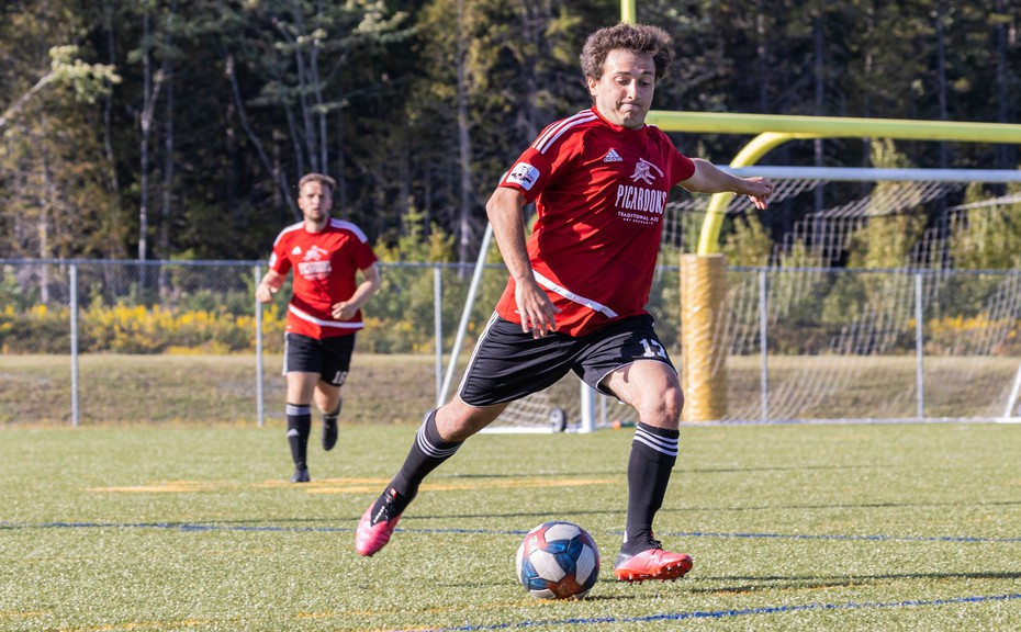 Tom Pheulpin, of the Fredericton Picaroons Red team, is about to boot the ball in New Brunswick Premier Soccer League action. The Reds men's and women's teams will host their respective league finals.