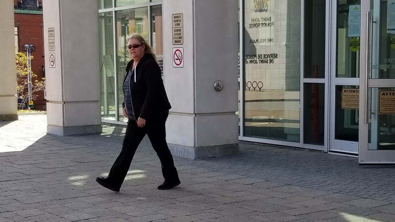 Christina Phinney, pictured here in this file photo, leaves the Saint John Law Courts. She's now set to be sentenced on Nov. 1 for stealing from the Saint John Airport.
