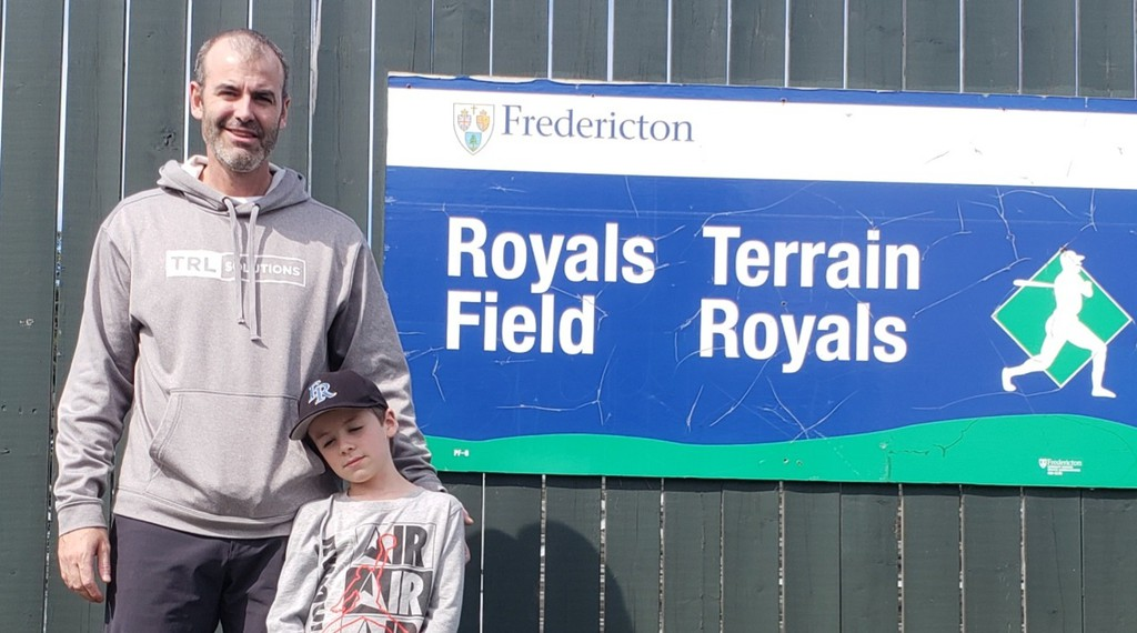 Jody Peterson, with his seven-year-old son Ty, outside Royals Field. After running the Fredericton Royals senior baseball program for 14 years, Peterson is ready to hand the keys to the program over – but there's no one to accept them.