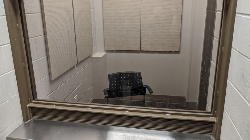 The prisoner-lawyer consultation room off one of the courtrooms at the Moncton Law Courts, from the inmate's vantage point.