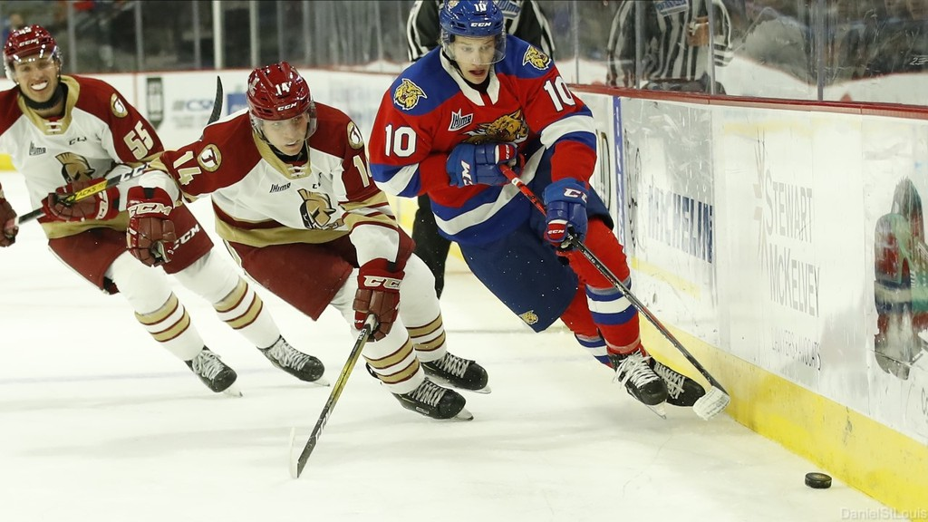 Moncton Wildcats forward Philippe Daoust tries to carry the puck up the boards while pursued by Acadie-Bathurst Titan forwards Alexis Dube (55) and Yannic Bastarache (14) during QMJHL play earlier this season at the Avenir Centre.