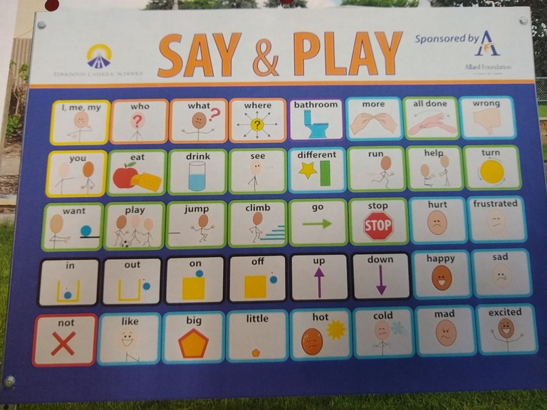 """The photo shows a """"Say and Play""""sign being installed at Sussex Corner Elementary School thanks to a grant from the Sussex Community Foundation this month."""