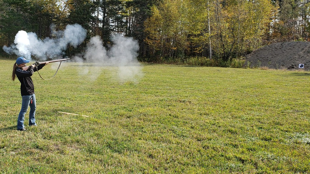 Melanie Speartzof Manitoba fires her musket at a turkey paper target at Kings Landing Historical Settlement on Saturday as part of the annual Thanksgiving celebration.