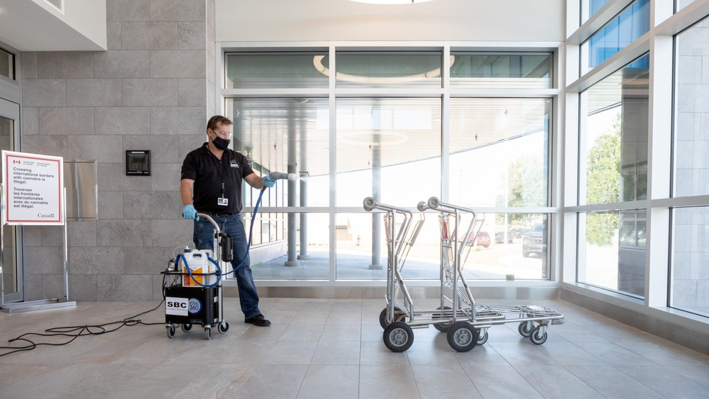 A staffer implements cleaning protocols at the Fredericton International Airport to comply with COVID-19 health and safety guidelines.