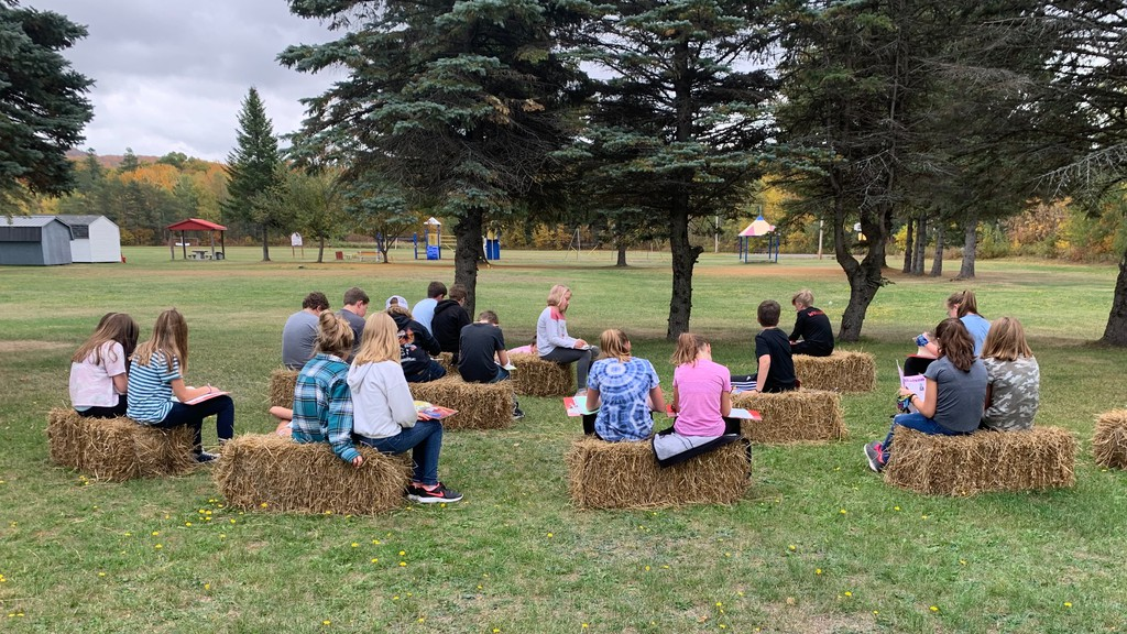 Florenceville Middle School students enjoy an outdoor class thanks to a donation of straw bales from Captain McKenzie's Market in Debec.