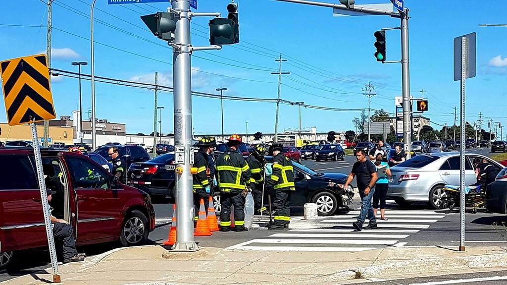 Emergency workers attend to a crash in Fredericton in 2019. While there's been a drop in crashes overall in the city in 2020, the number of crashes with injuries has remained mostly the same, despite increased ticketing efforts for speeding and distracted driving.