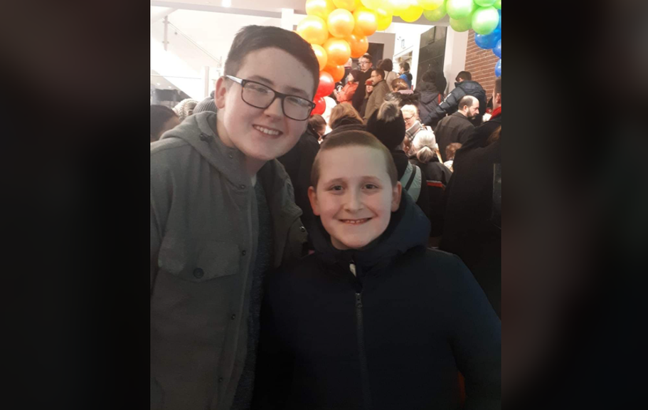 Lindsay O'Blenis' sons Parker, left, and Tyler both attend Beaverbrook School in Moncton but haven't been to class since the outbreak at the Manoir Notre-Dame early last week. O'Blenis has kept her boys home because Tyler has a health issue.