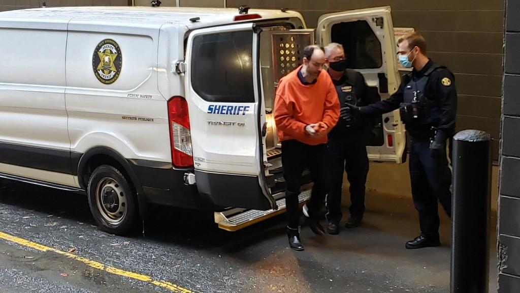 Matthew Raymond arrives for his murder trial Wednesday.