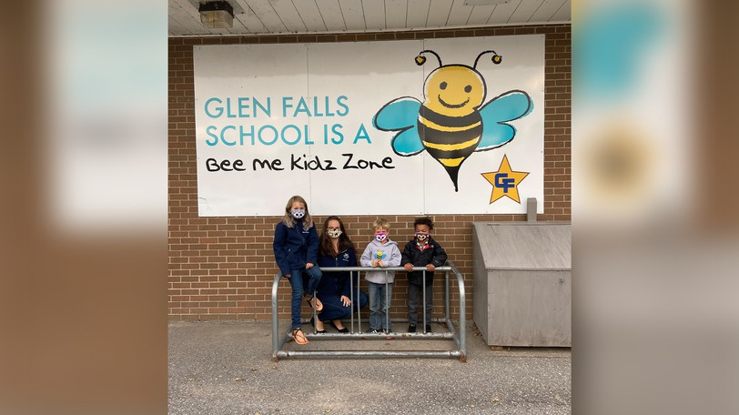 From left: Chloe Short, Jodie Sutton, Carter Short and Jax Short stand outside the Bee Me Kidz Glen Falls School sign. Bee Me Kidz has recently expanded to serve families in the St. Stephen area.